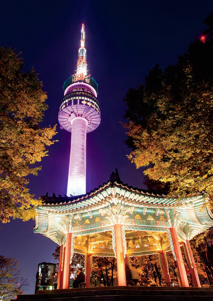 A nighttime view of N Seoul Tower and an octagonal pavilion at Namsan Mountain