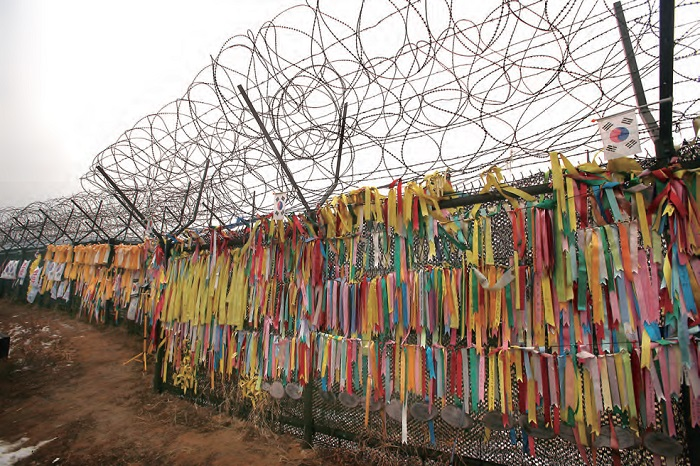 Prayer ribbons tied to a barbed wire fence located between the DMZ and Freedom Bridge